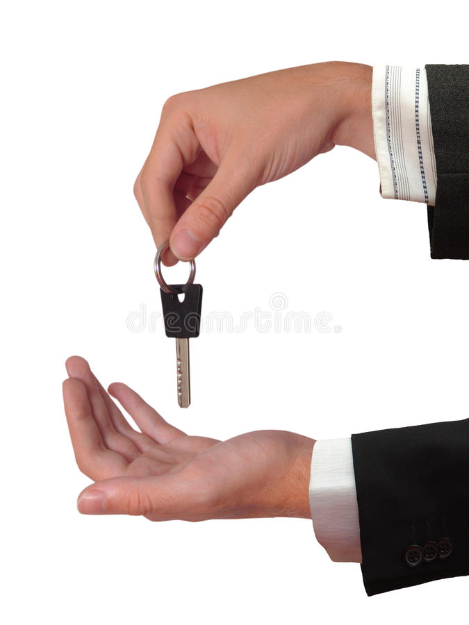 The Hand giving the Key of the House royalty free stock images