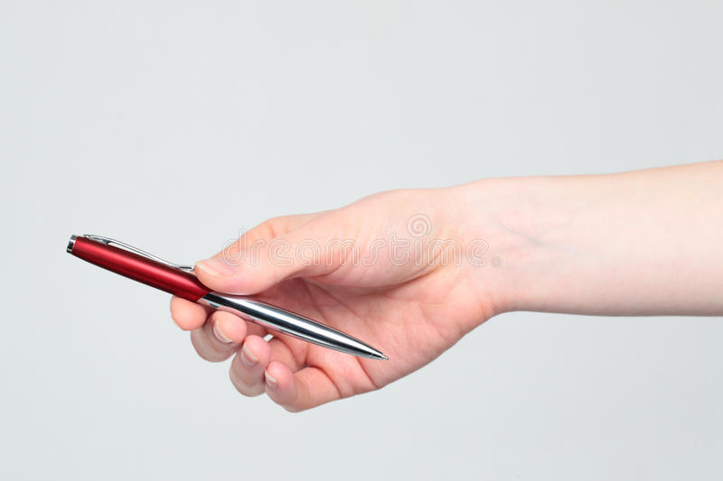 Hand Giving a Pen stock image. Image of hand, give, stationery ...