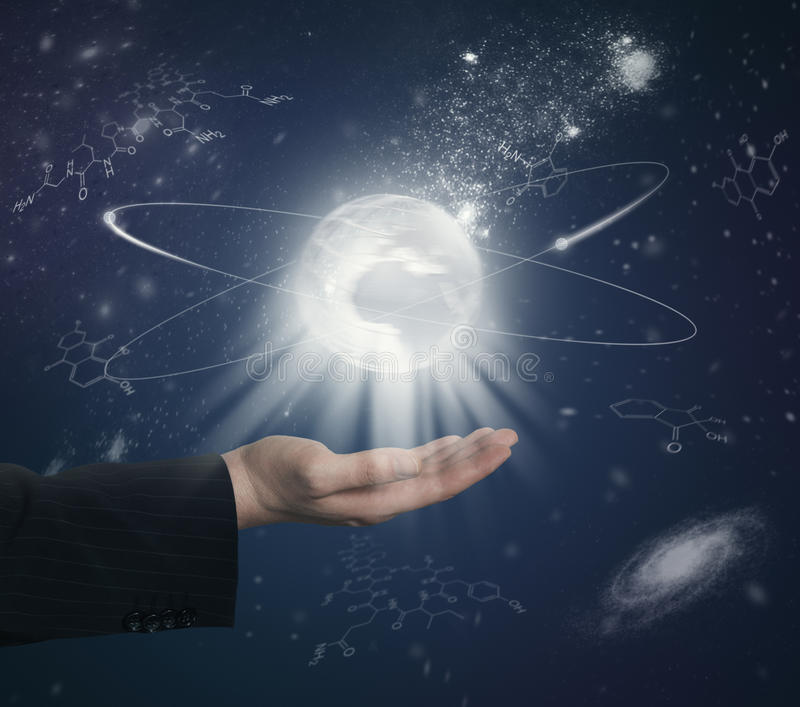 Hand with globe and chemical formulas stock image