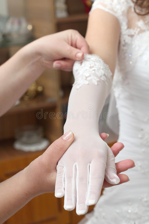 Hand in a glove royalty free stock photos