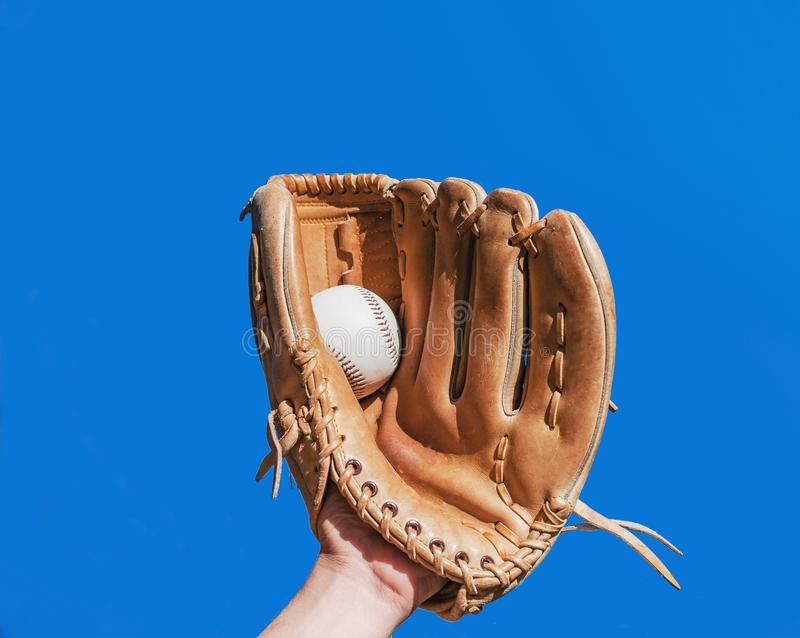 Hand in glove for baseball game caught a leather white ball on royalty free stock image