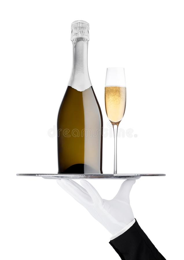 Hand with glove holds tray with champagne bottle. And glass on white background royalty free stock images