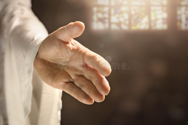 Hand of God or Jesus reaching out stock photography