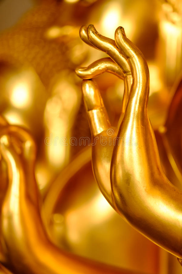 A hand of a golden Buddha statue royalty free stock photo