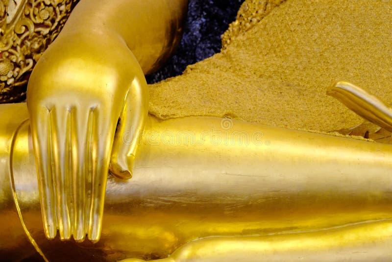 Hand of Golden buddha in thailand stock photo