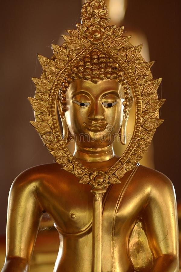 Hand of golden of buddish state in the art style ,Wat Krathum Suea Pla temple ,Bangkok stock photography