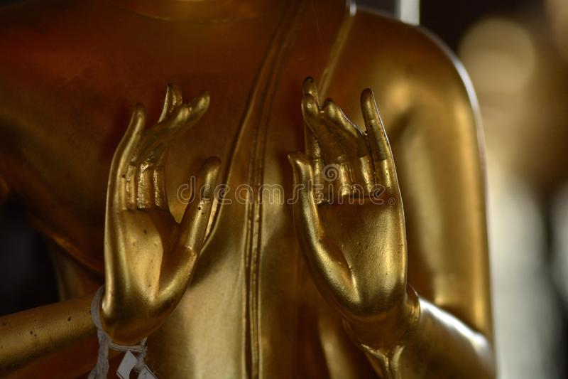 Hand of golden of buddish state in the art style ,Wat Krathum Suea Pla temple ,Bangkok royalty free stock image