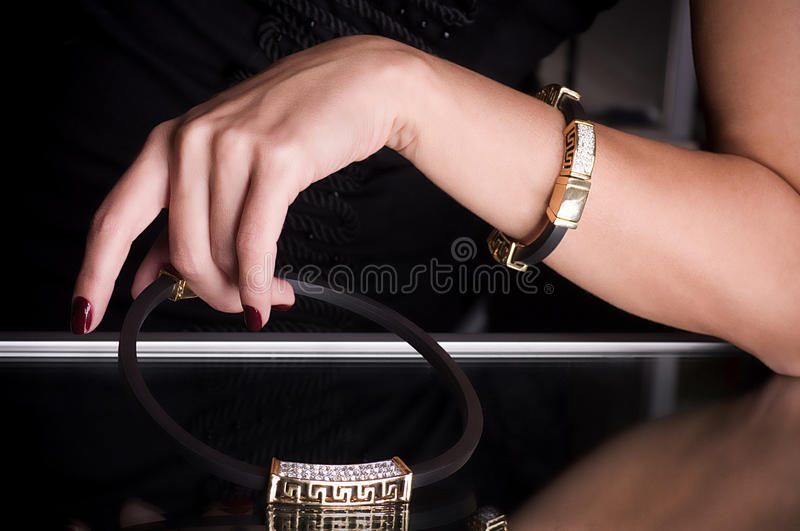 Hand with golden jewelry stock photo