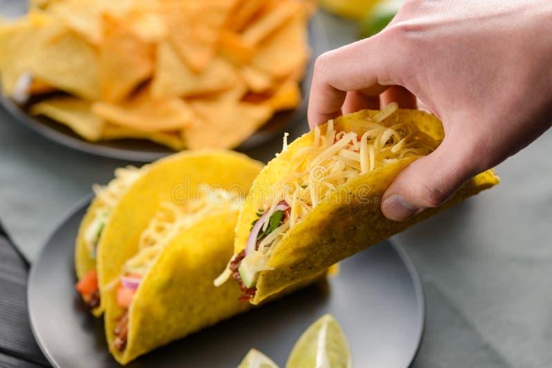 Hand grabbing a taco shell royalty free stock photography