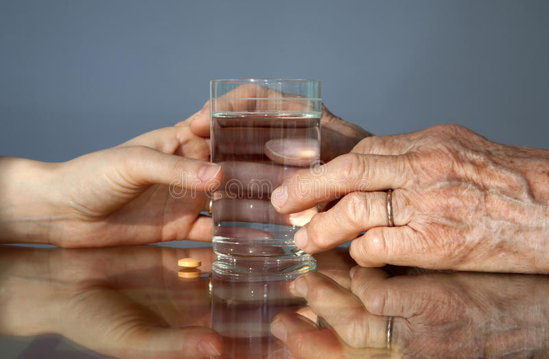 Hand Of Grandmother And Women With A Pill Royalty Free Stock Photography