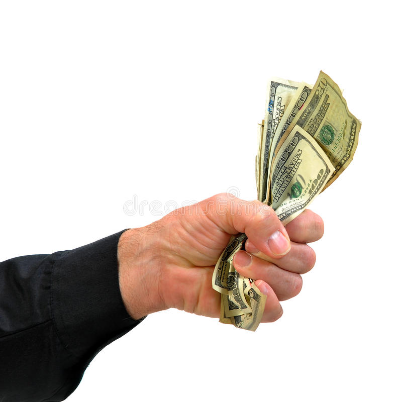 Hand grasping hold of money stock image