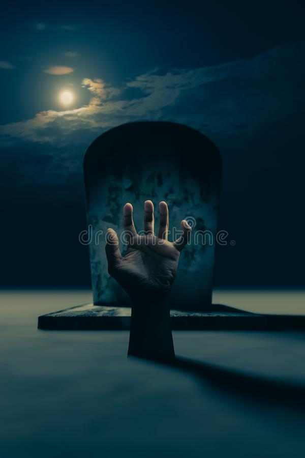 Hand in the grave royalty free stock images