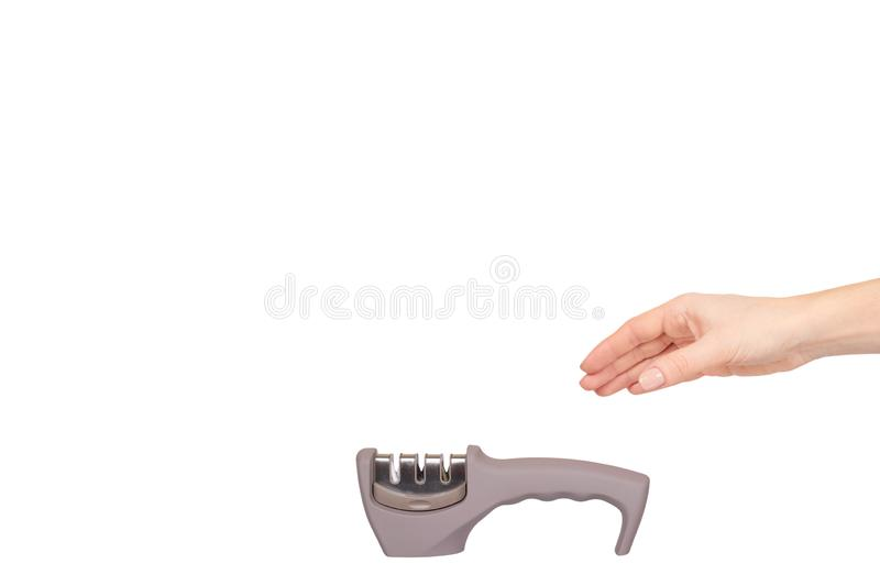 Hand with gray knife sharpener with handle, kitchen utensil. Isolated on white background. Copy space template, object, equipment, metal, steel, tool stock photo