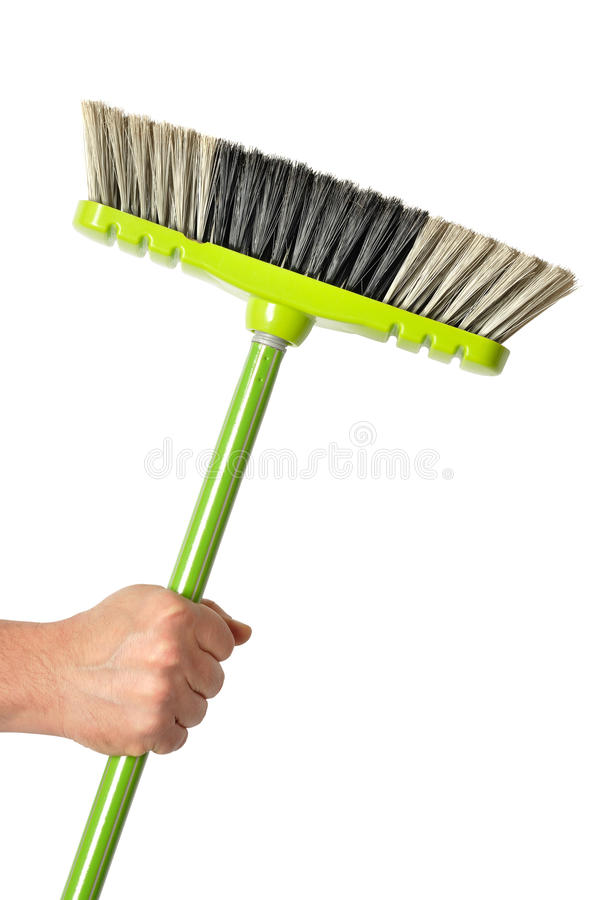 Hand with Green Broom stock image