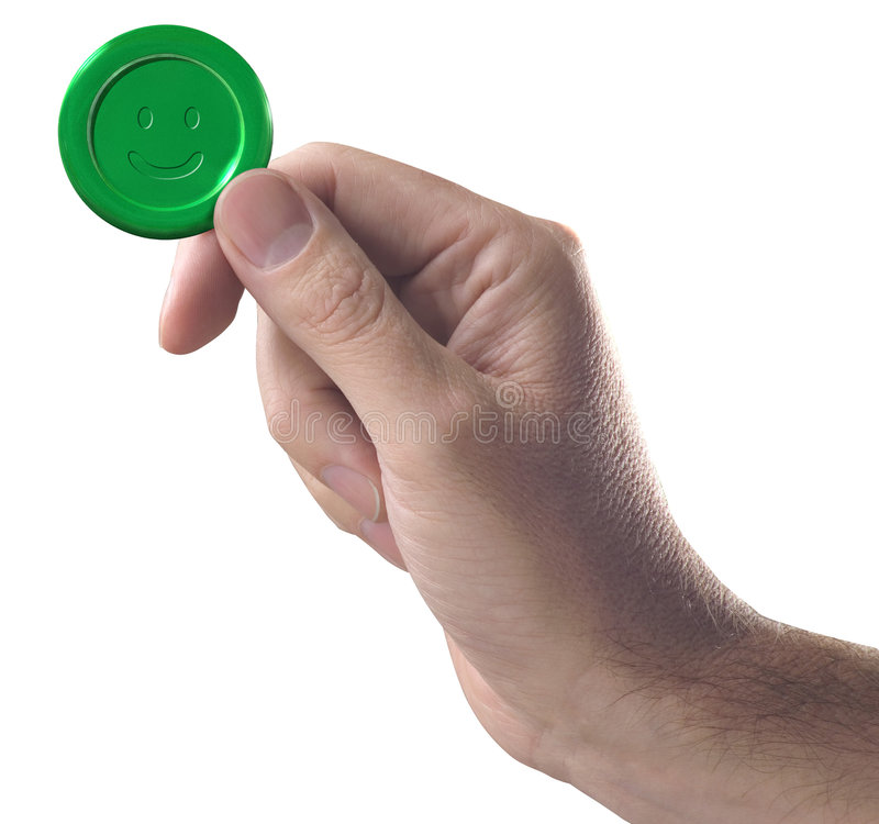 Hand with green button. Hand holding green button with smile royalty free stock images