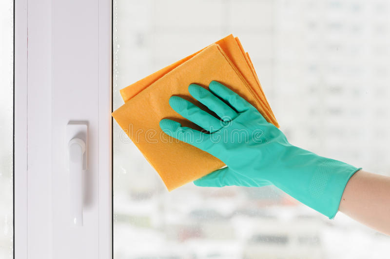 Hand in a green glove stock image