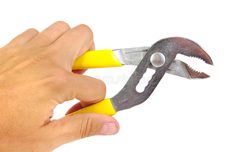 Hand with groove pliers isolated on a white stock photography