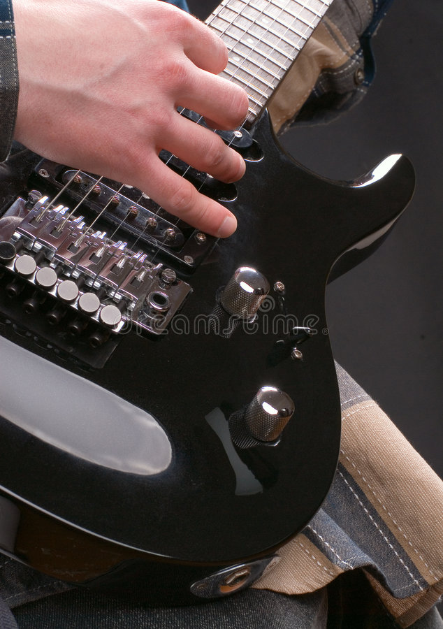 Hand on a guitar royalty free stock photos