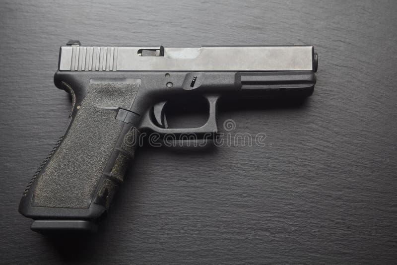 Hand gun on black table royalty free stock image