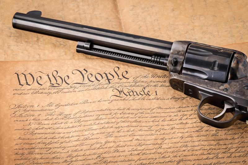 Constitution of the united States and an old classis revolver stock photography