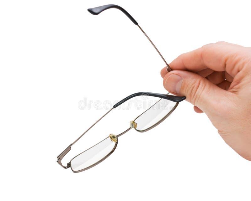 Hand hält Gläser an lizenzfreies stockbild