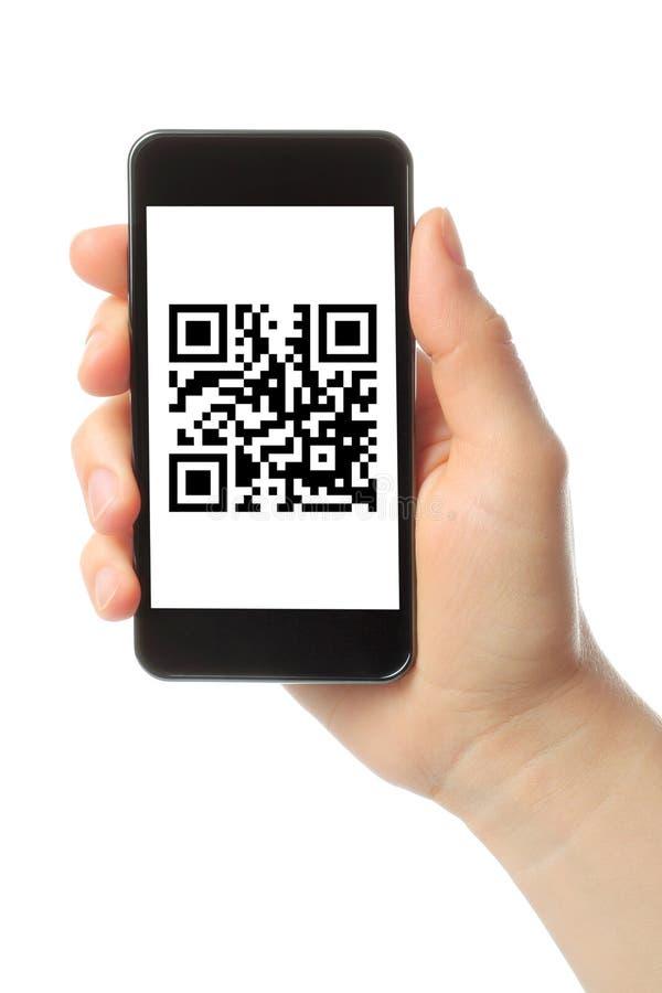 Hand hält intelligentes Telefon mit QR-Code stockbilder