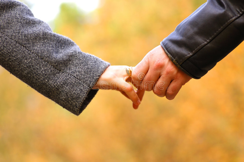 Hand-in-hand royalty free stock photo