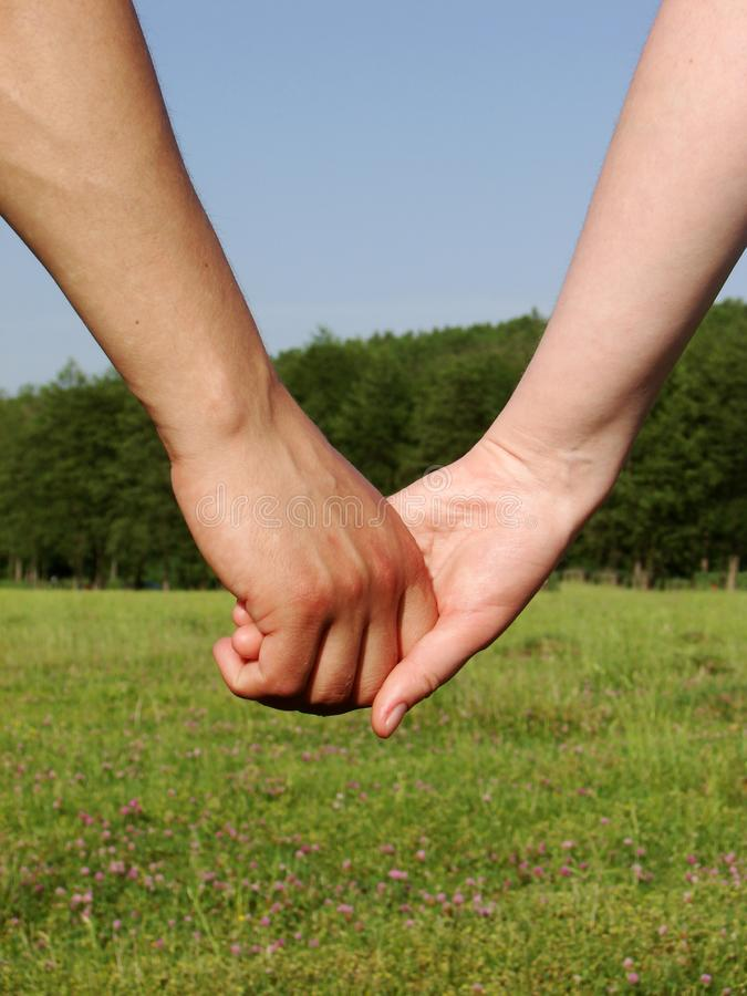Download Hand-in-hand Royalty Free Stock Photography - Image: 3001087