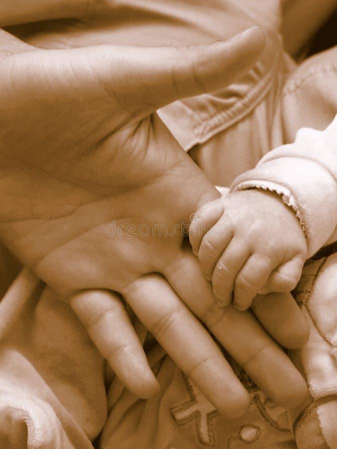 Hand in hand stock photo
