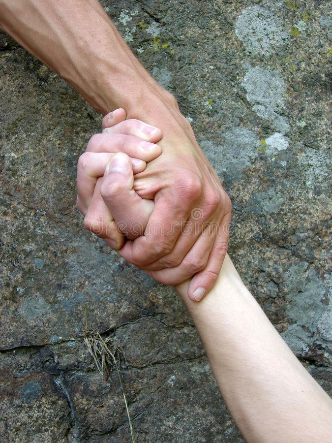 Hand in a hand royalty free stock photos