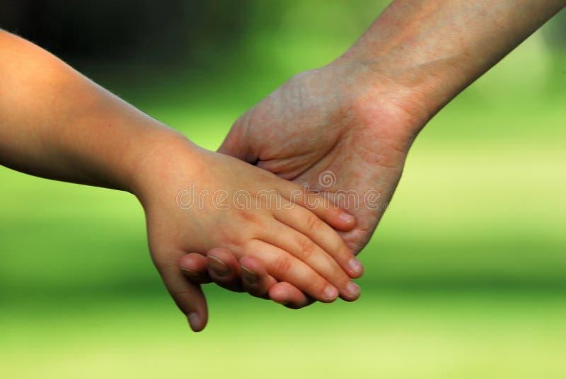 Hand in hand stock fotografie