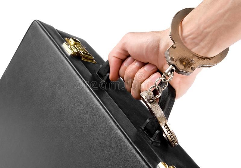Download Hand On Handcuffs With A Briefcase Stock Photo - Image of businessperson, suitcase: 9667460
