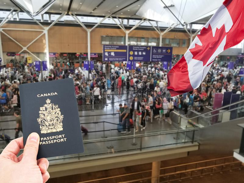 Hand handing Canadian passport. At Canadian airport custom counters, returning home concept royalty free stock photos