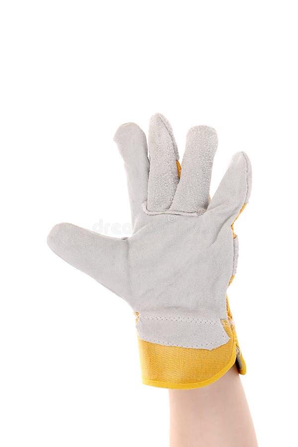 Hand in Handschuhshows fünf. stockfotografie