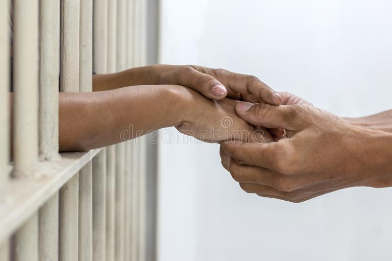 Hand handshake husband and wife who were imprisoned. stock images