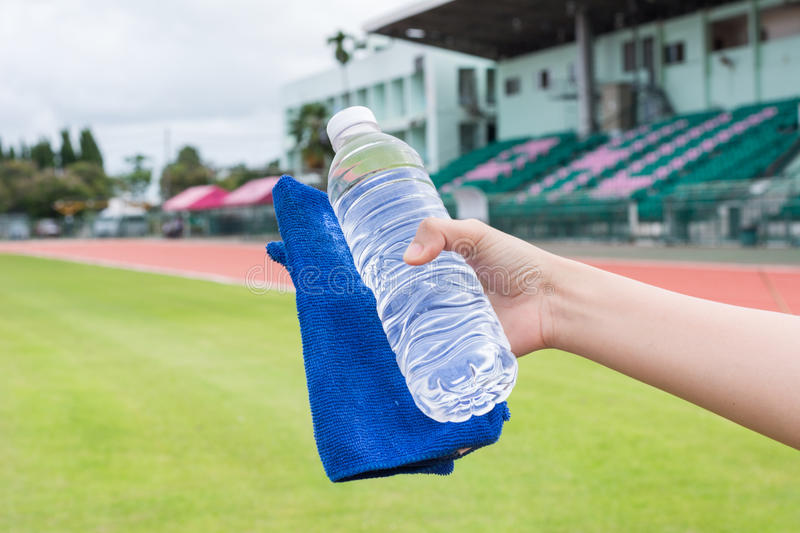 Hand of healthy woman Holding fresh water bottle, soft - focus stock photos