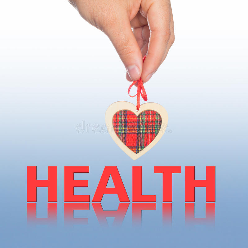 Hand with heart and word health royalty free stock photography