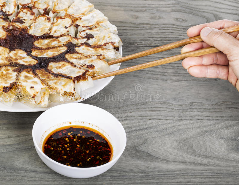 Hand Held Chopsticks Reaching For Dumplings Royalty Free Stock Photo