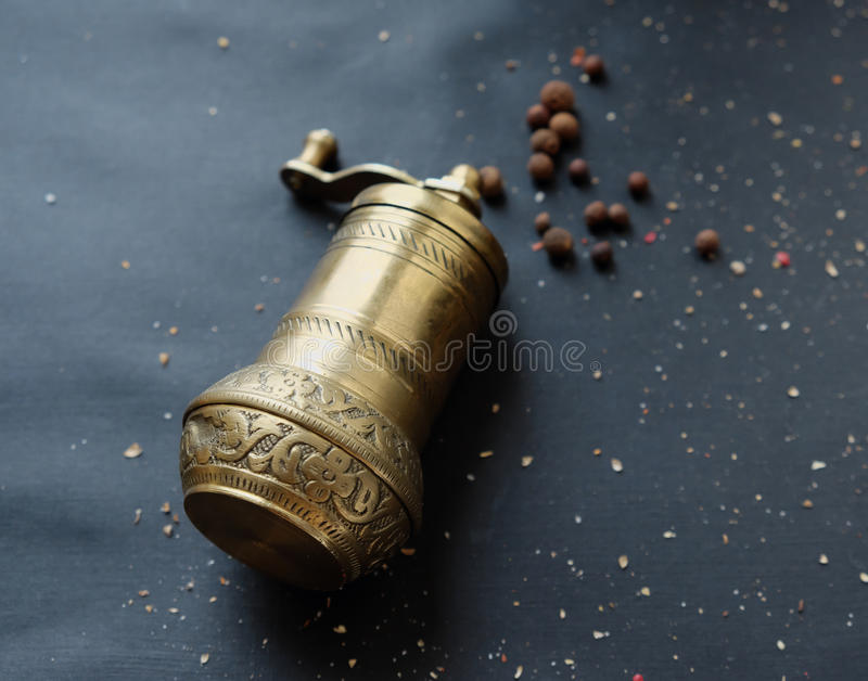 Hand-held coffee grinder on the table. Top view royalty free stock image