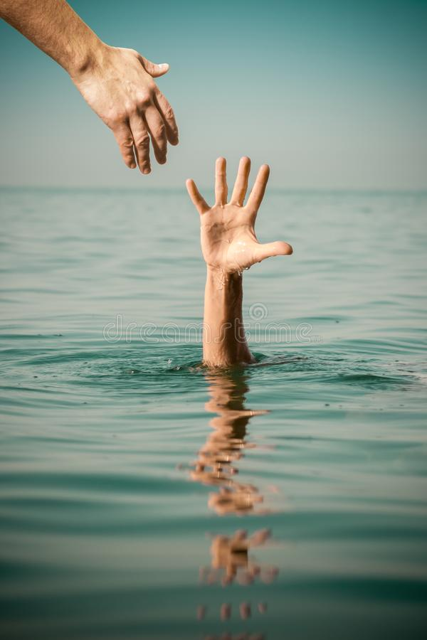 Hand Of Help For Drowning Man Life Saving In Sea Water Stock Image - Image  of drown, help: 112247289