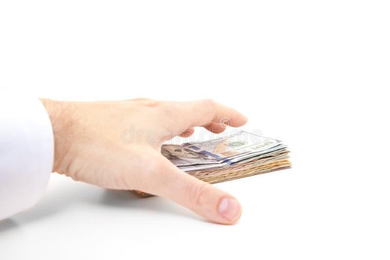 Hand het grijpen stapel van dollarnota's stock fotografie