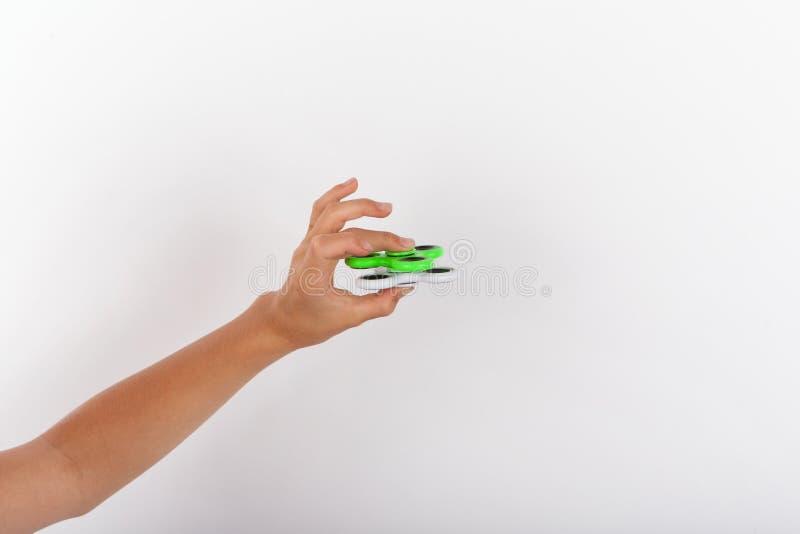 Hand het spelen met twee friemelt spinners royalty-vrije stock foto