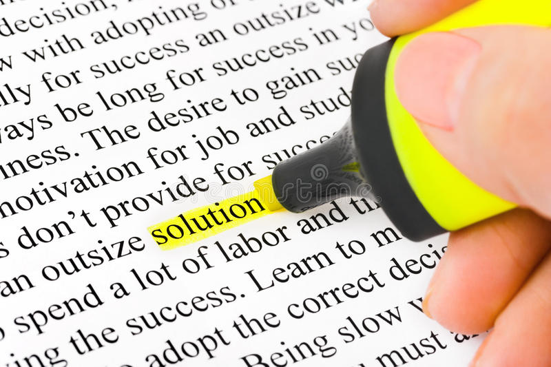 Hand With Highlighter And Word Solution Royalty Free Stock Photo