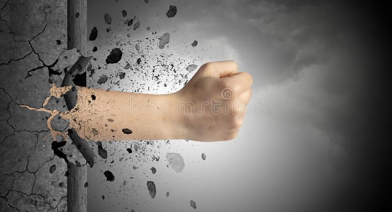 Hand hits intense and breaks stonewall royalty free stock photo