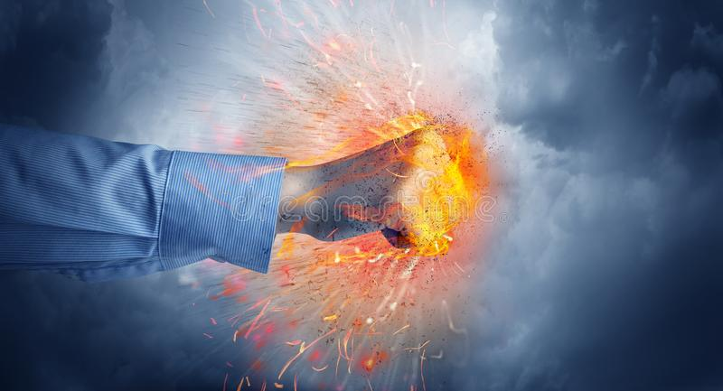 Hand hits intense and makes fire stock image