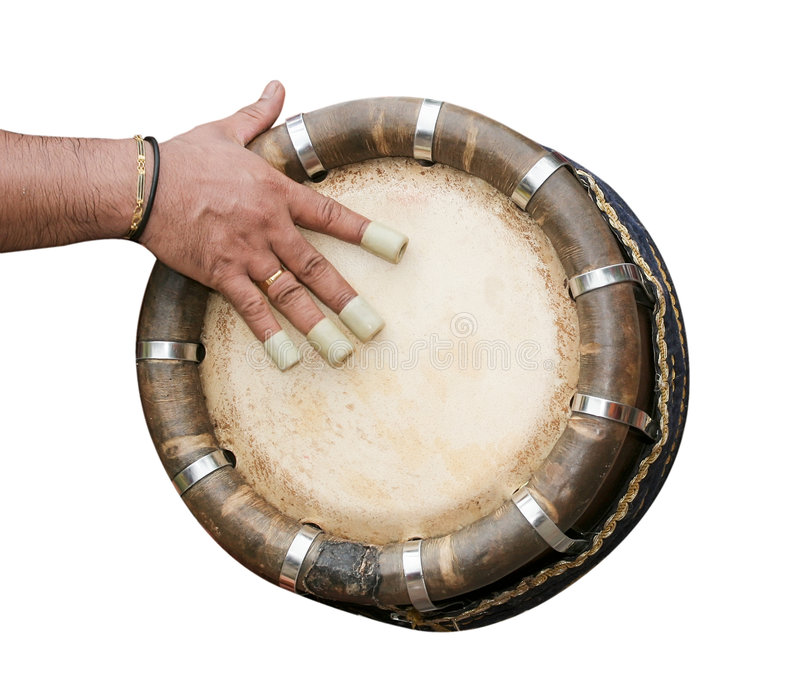 Hand hitting Indian drum. One hand playing Indian drum isolated on white, batu caves, Malaysia stock images