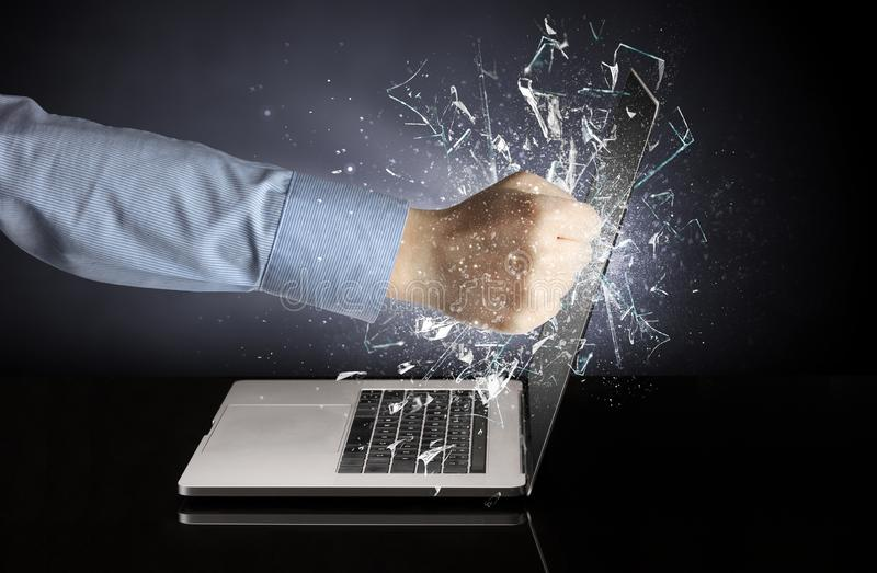 Hand hitting laptop screen screen. Hand hitting strongly laptop screen glass stock photography