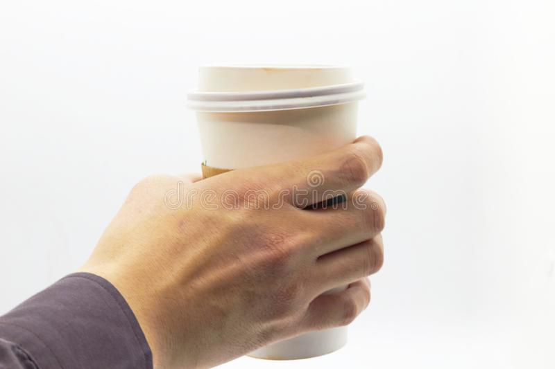 Hand is hloding plastic cup on isolated white background royalty free stock photos