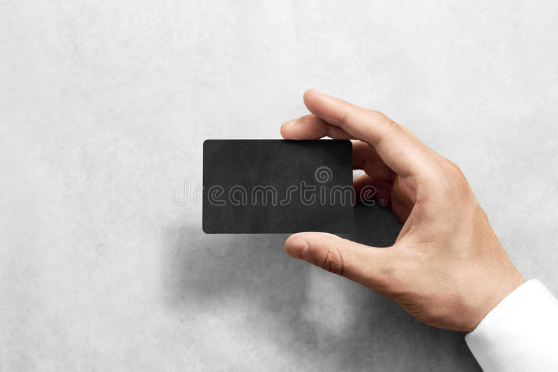 Hand hold blank black craft card mockup with rounded corners royalty free stock photo