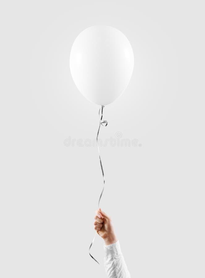 Hand hold blank white balloon mock up . Baloon mockup. Hand hold blank white balloon mock up . Baloon mockup art design. Pattern, logo, texture prentation.rr stock photo